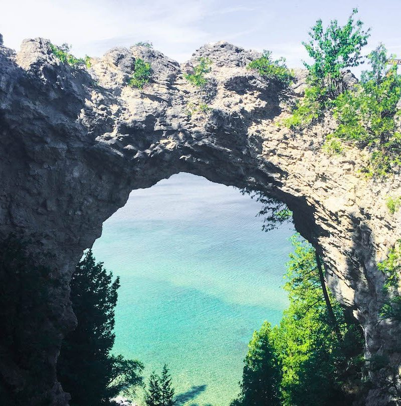 Arch Rock on Mackinac Island with crazy blue water behind it