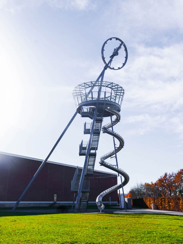 A giant rotating clock tower that doubles as a slide at the Vitra Museum, Germany