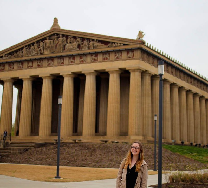 Addie smiling in front of the Nashville Parthenon