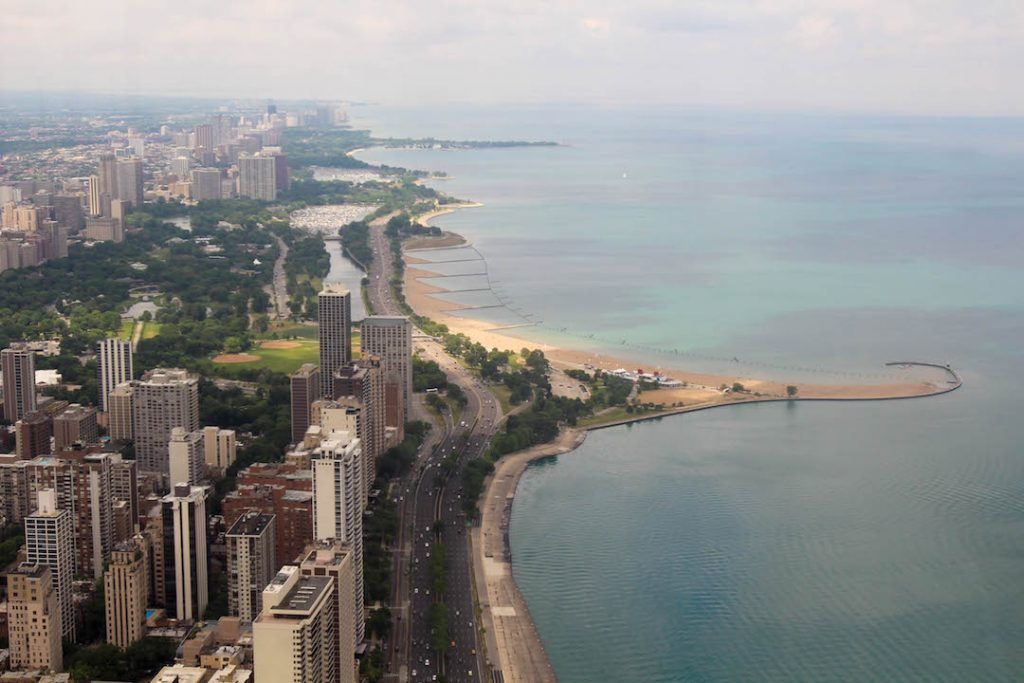 looking down at the buyildings and beach in chicago