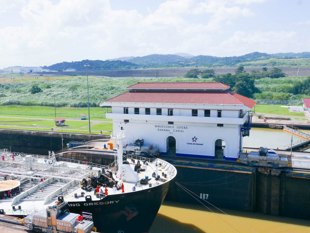 A boat passing through Miraflores Locks on the Panama Canal in Panama City