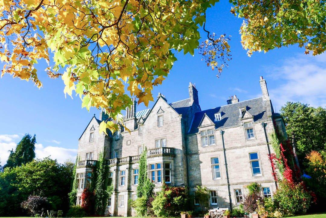 Pitreavie Castle in Dunfermline, Scotland framed by leaves
