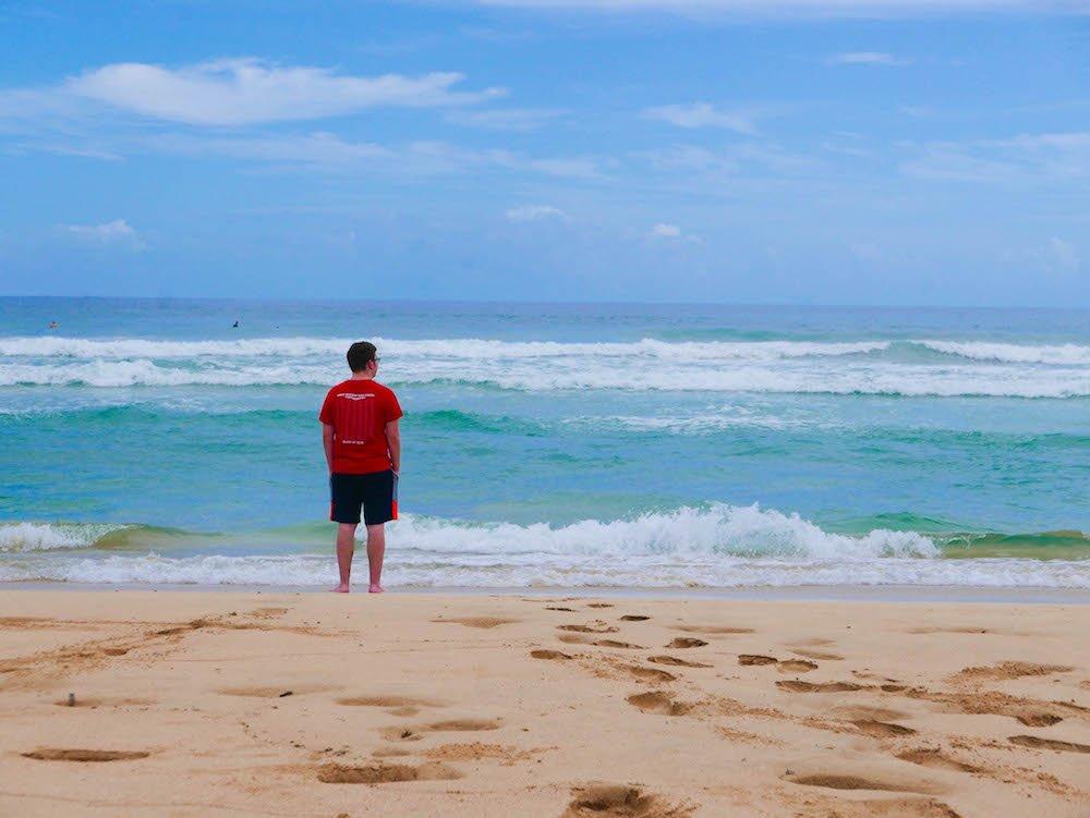 Daniel staring out towards the horizon on Wizard Beach, Isla Bastimentos, Panama