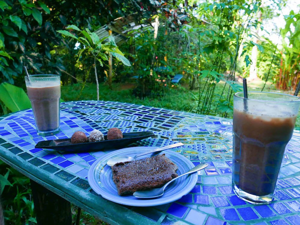 Truffles, a brownie, and mochas on a tiled table at Up in the Hill on Isla Bastimentos, Bocas del Toro, Panama