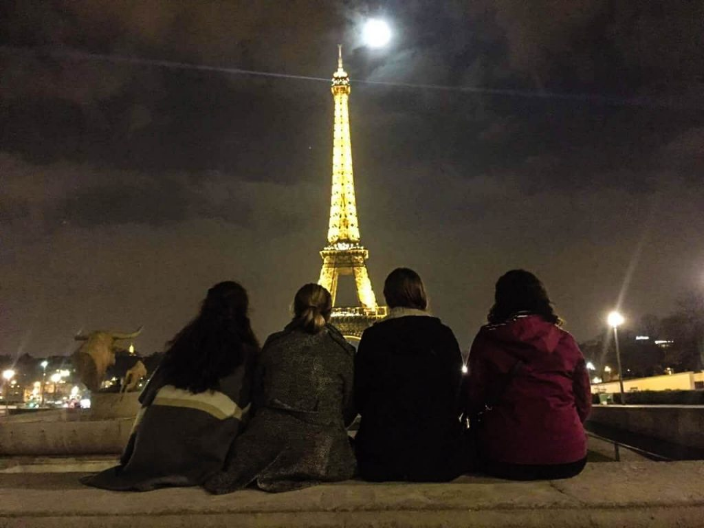 Girls Eiffel Tower at night Paris France