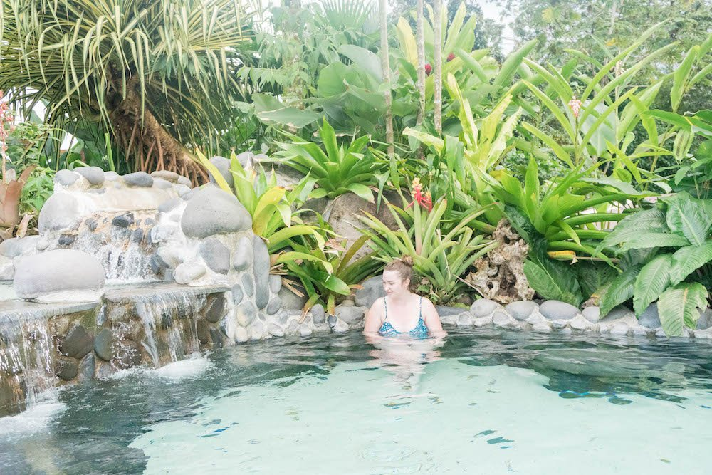 Addie looking at the water in the hot springs of Arenal Volcano
