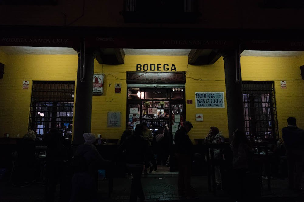 Yellow Storefront of Bodega Santa Cruz Las Columnas Tapas Bar in Seville, Spain