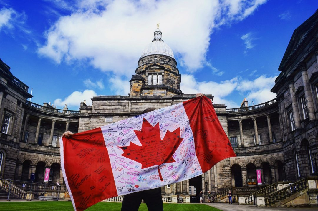 The Canadian flag, covered in signatures after studying abroad in Ediburgh