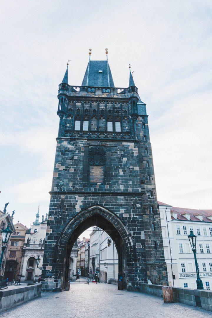 The imposing gate entrance to Charles Bridge in Prague