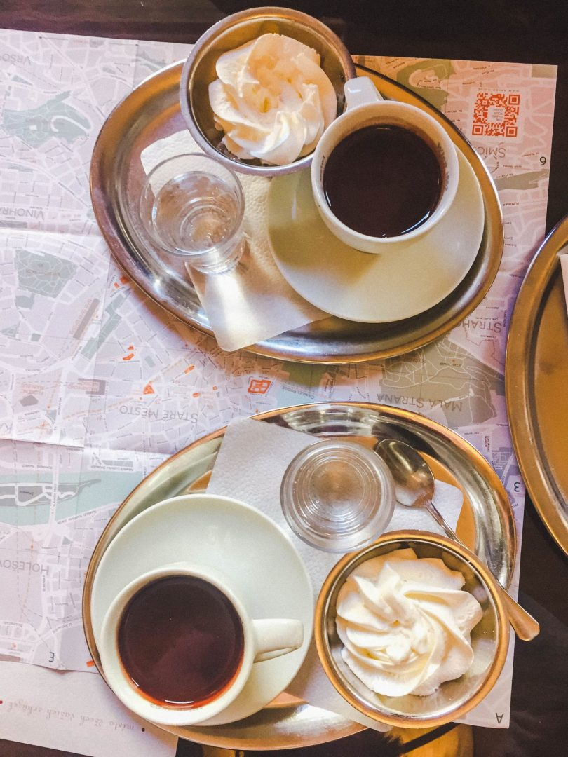 Two platters of whipped cream and hot chocolate in Cafe Louvre, Prague