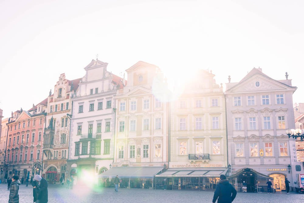 Light shining through the clouds on the Old Town Square in Prague
