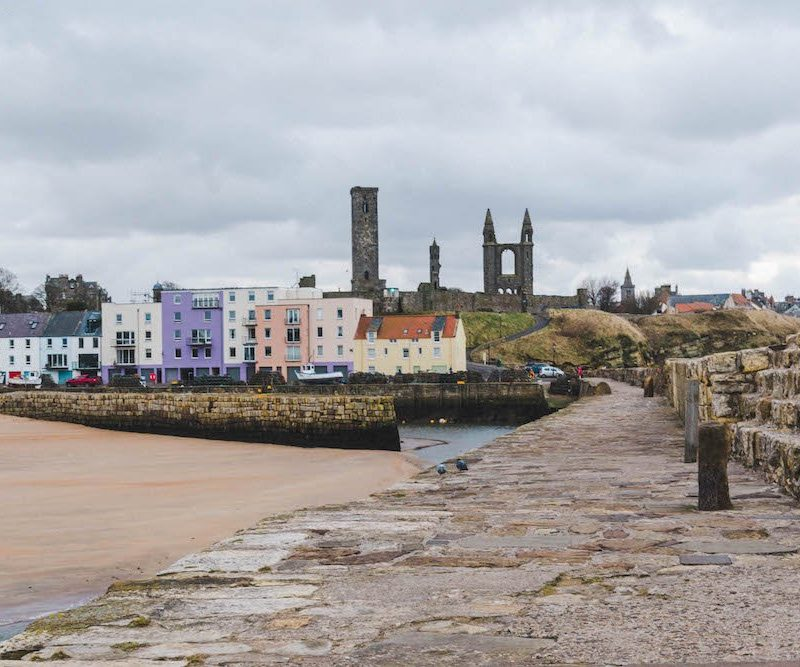 looking down the pier towards east sands and the cathedral in St. Andrews, Scotland