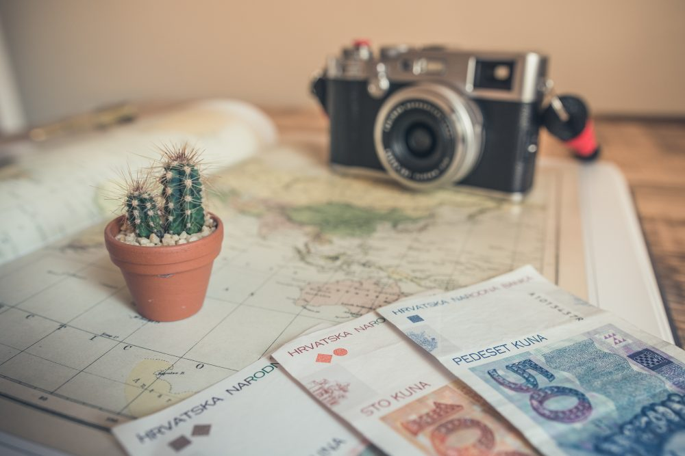 camera and euros on top of a map