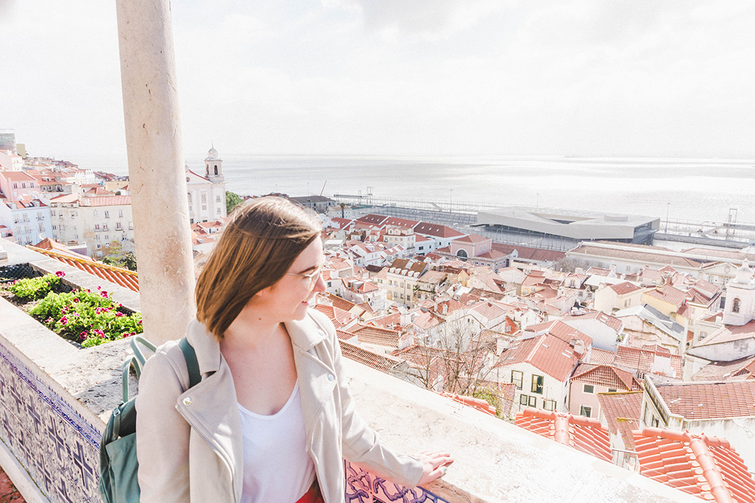 Addie looking over the city of Lisbon at the Miradouro de Santa Luzia