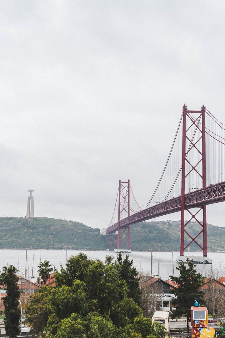 The Ponte de 25 Abril stretching across the water towards the Cristo Rei in Lisbon, Portugal
