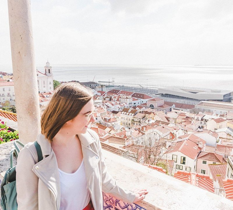 Addie staring out across Lisbon from a viewpoint