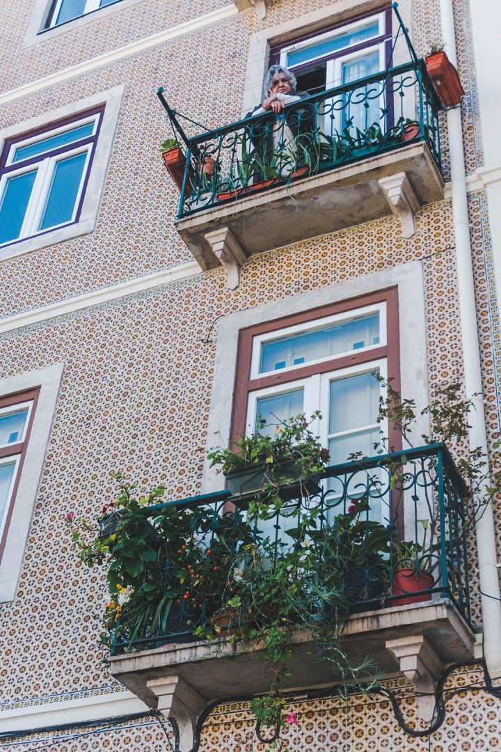 A grandma on a balcony in Lisbon, Portugal