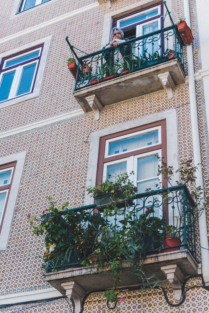A grandma on a balcony in Lisbon, Portugal