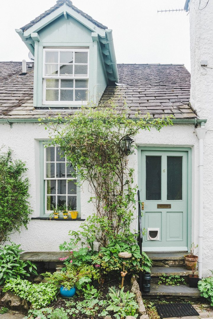 A cute white house with a blue door in Ambleside, Lake District, UK