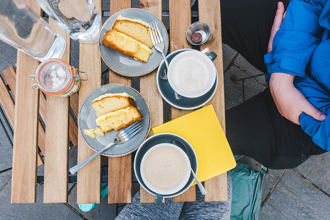 Delicious lemon cake and lattes from Kittchen Cat Cafe in Hawkshead, Lake District, England