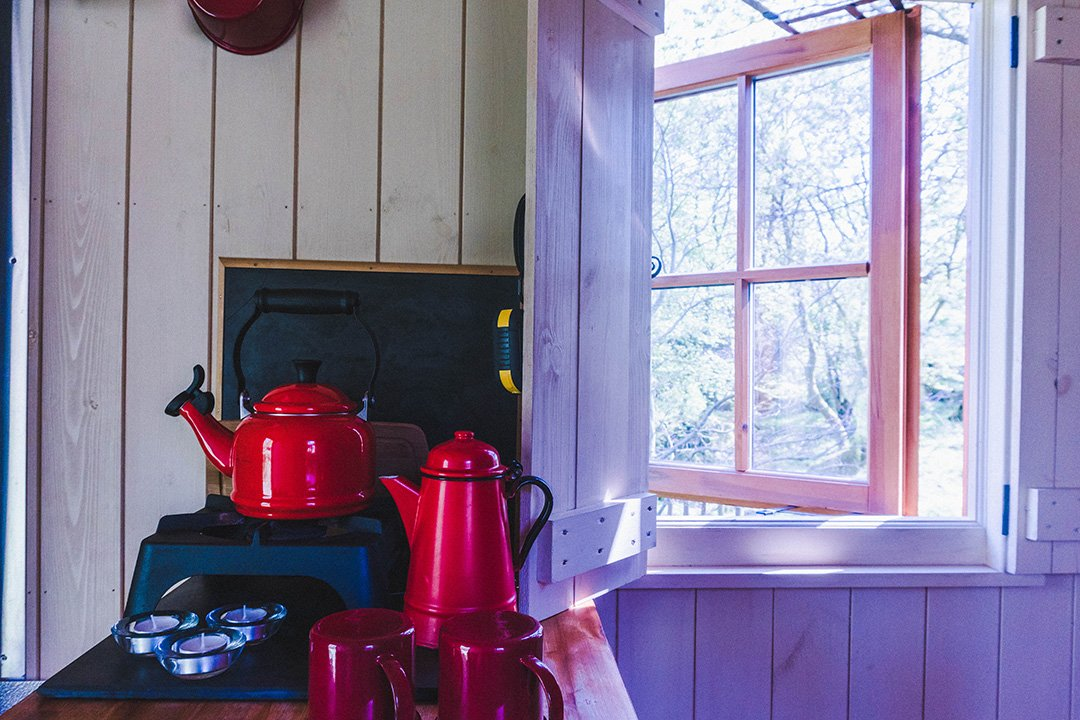 Red kettle on the stove of the Herdy Huts, Lake District glamping