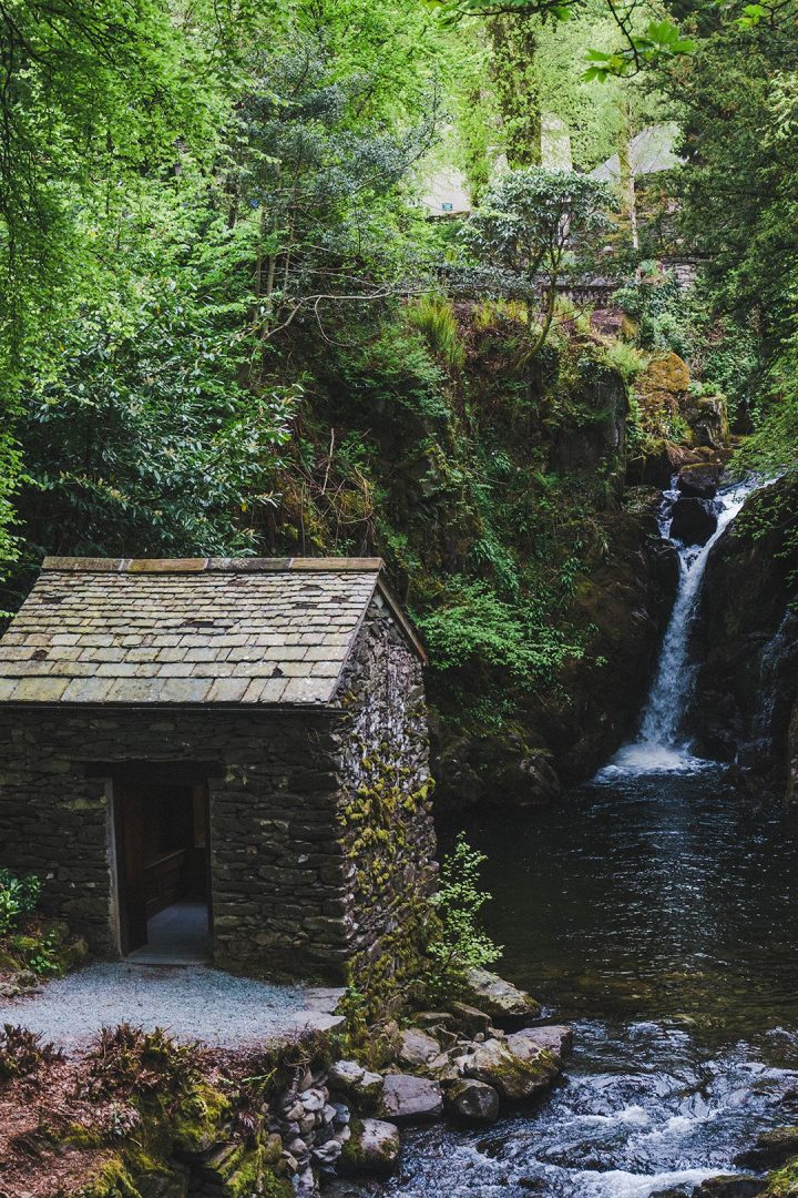 a small house set near a waterfall in the Lake District