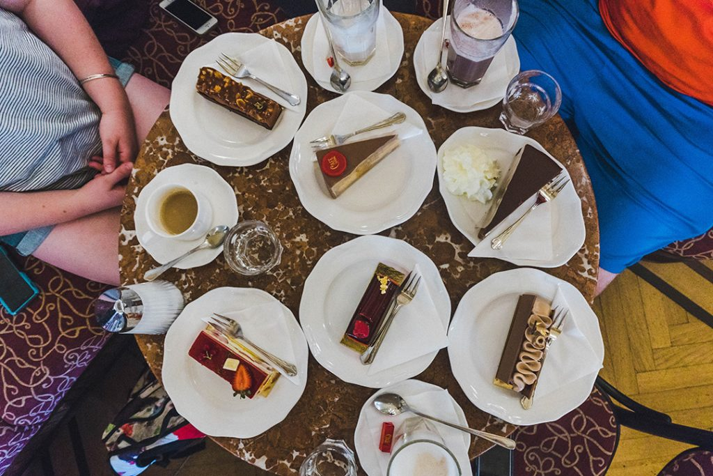6 slices of cake on one table in Cafe Central in Vienna, Austria
