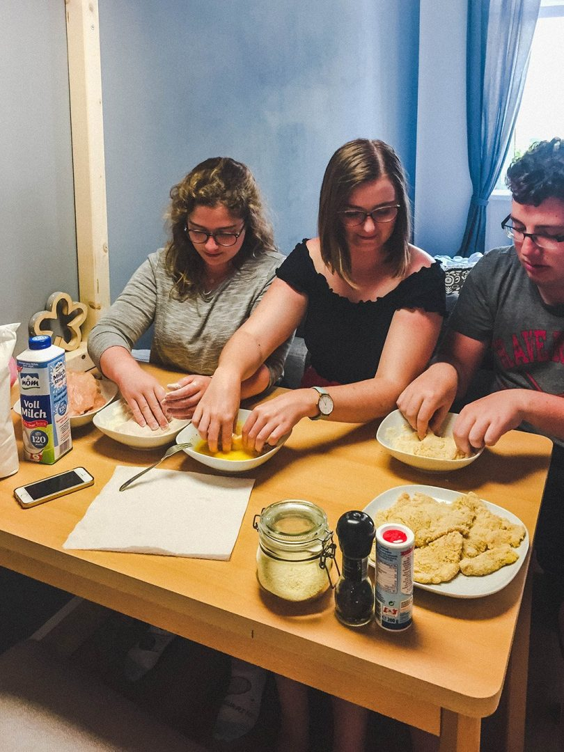 Learning to make schnitzel at Leoni's apartment in Vienna with Astrid and Daniel