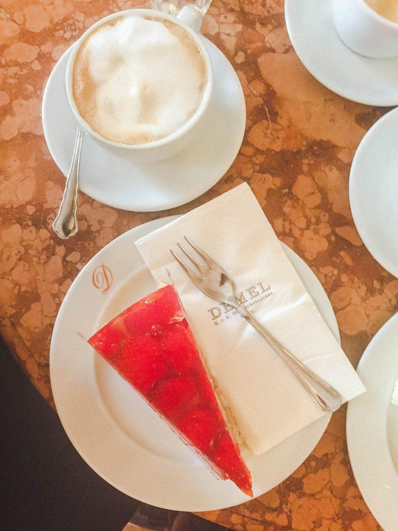 Strawberry cake and a melange coffee at DEMEL in Vienna, Austria