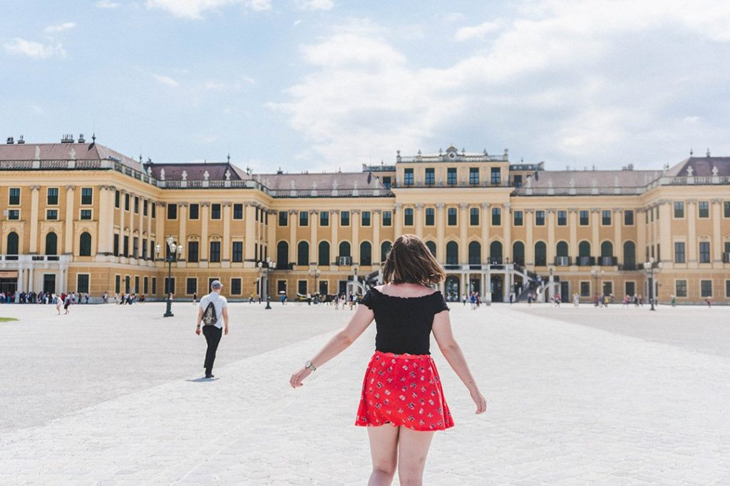 Addie running towards Schönnbrunn Palace in Vienna, Austria