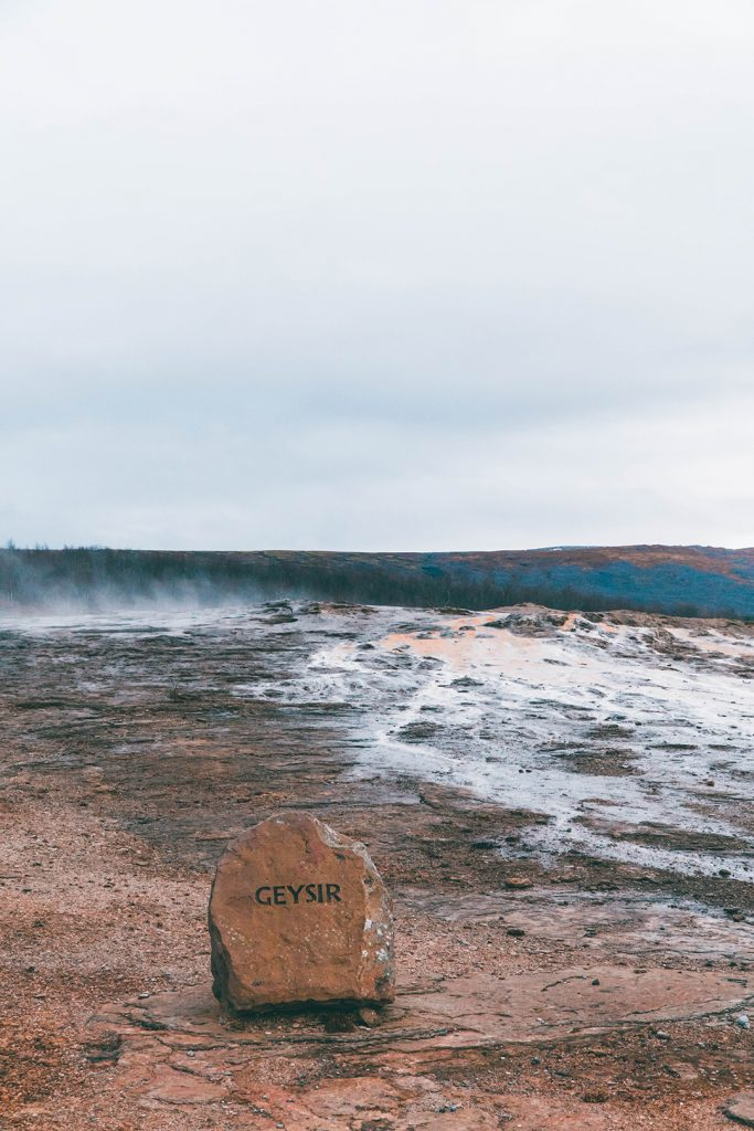 A rock with the word Geysir on it, denoting that this geyser is, in fact, the original geysir