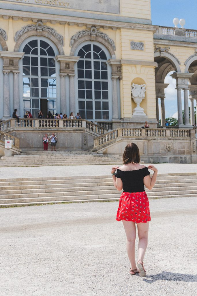 Addie looking at the Gloriette at Schönbrunn Palace in Vienna, Austria
