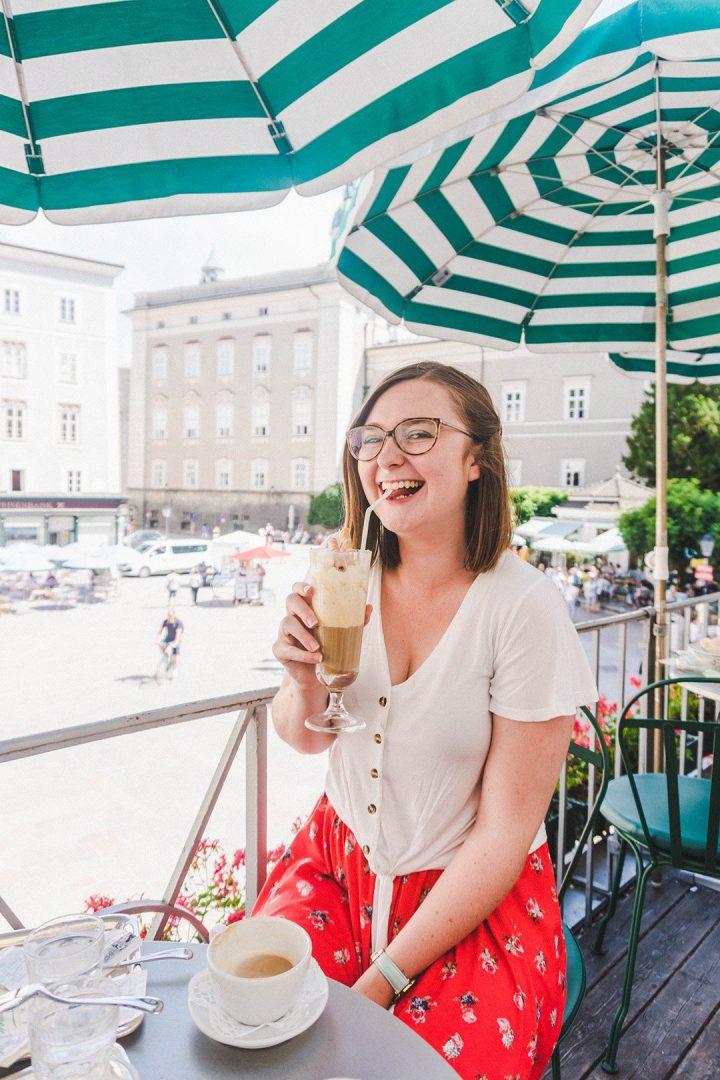 Addie sipping on an Eiskaffe at Cafe Tomaselli in Salzburg, Austria