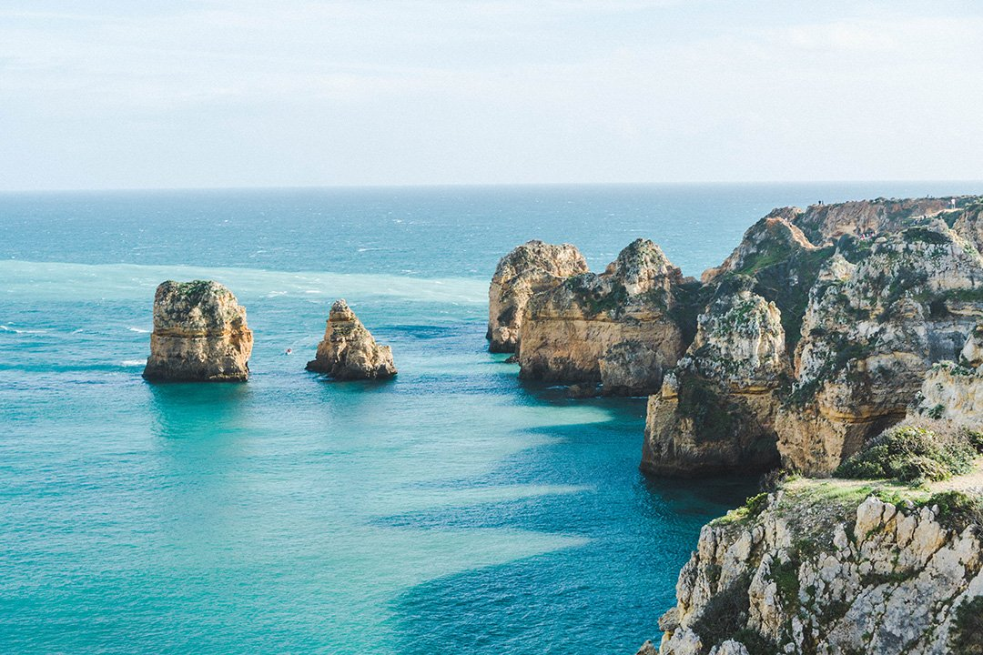 Cliffs in Lagos, portugal at the end of our hike where we reached some of the best beaches in Lagos, Portugal during 2 weeks in Portugal
