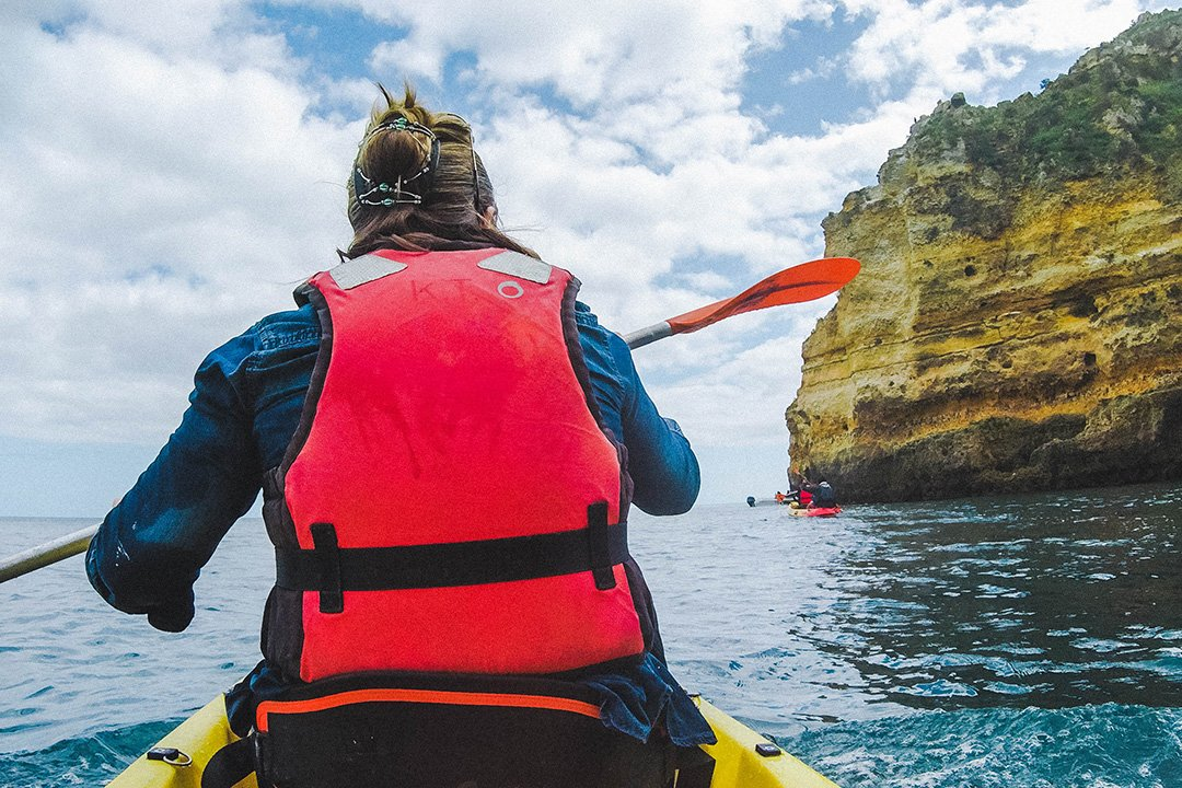 Madison paddling on our Kayak Tour in Lagos, Portugal -- on of the coolest things to do in Lagos Portugal