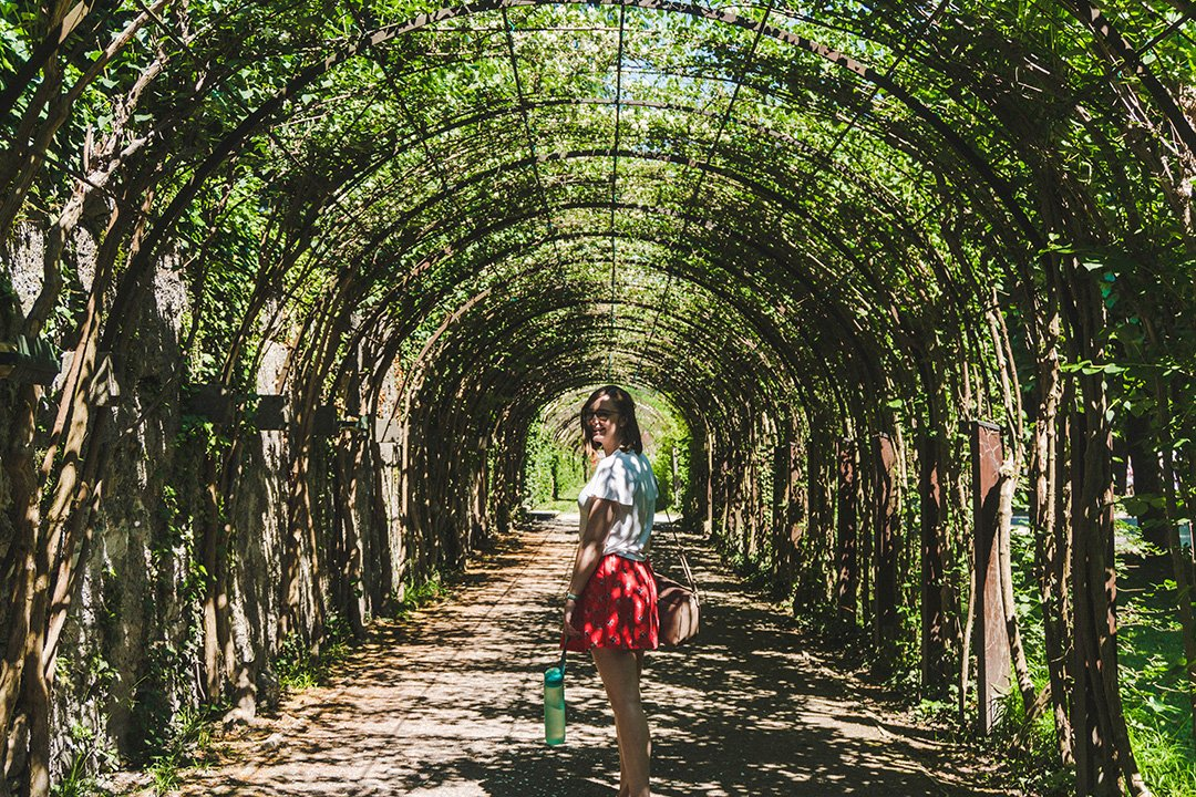 Addie wandering through an ivy tunnel in the Mirabell Gardens Salzburg, Austria