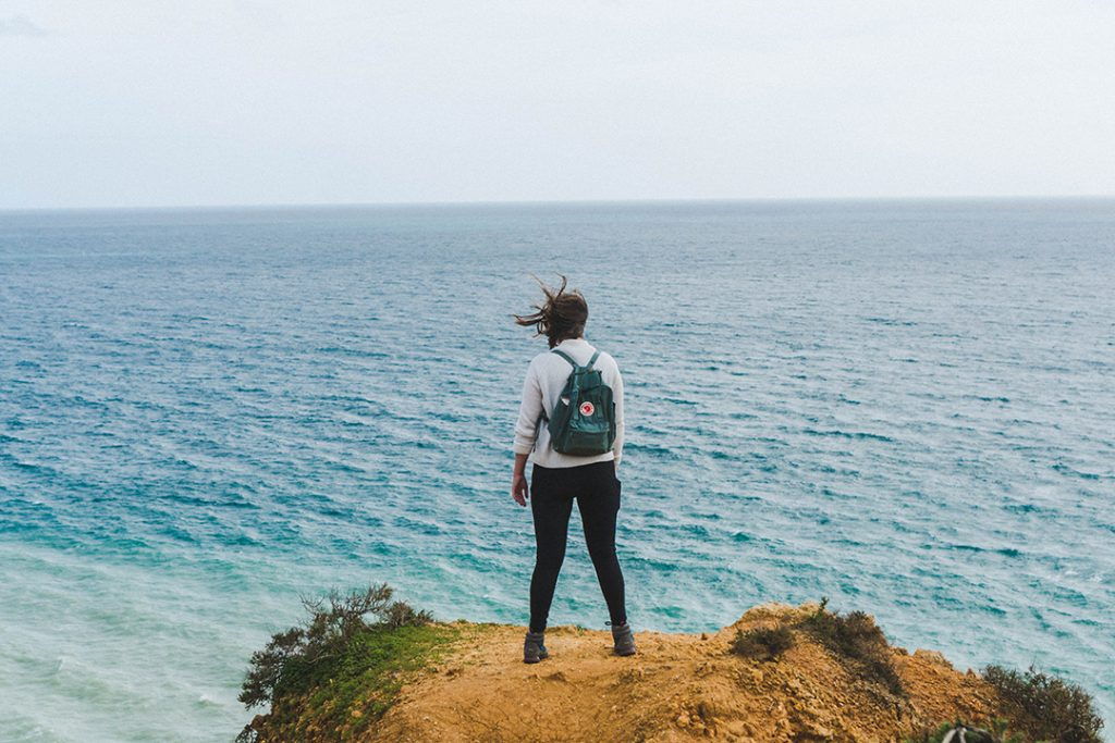 Addie staring into the distance on a hike in Lagos, Portugal