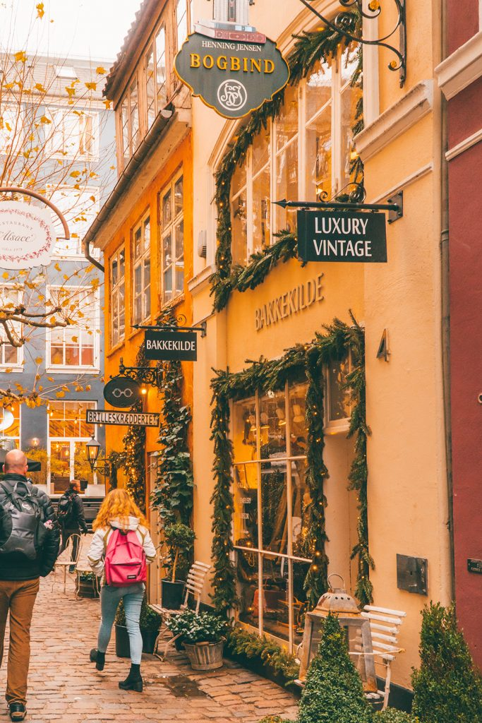 Megan walking through a hidden allyway in Copenhagen