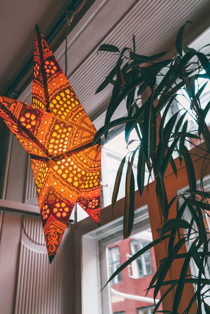 A Christmas star in the window of a coffee shop in Copenhagen, Denmark
