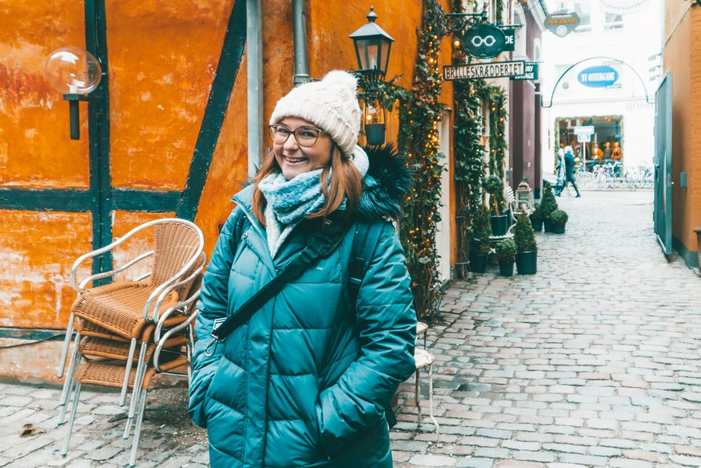 Addie smiling while all bundled up in Copenhagen