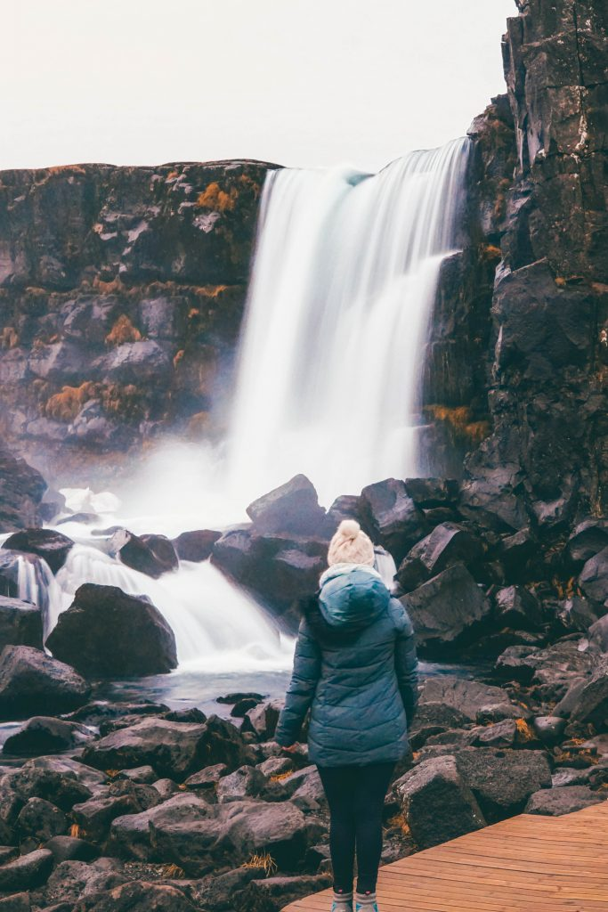 Addie gazing at a waterfall in Pingvellir National Park, Iceland