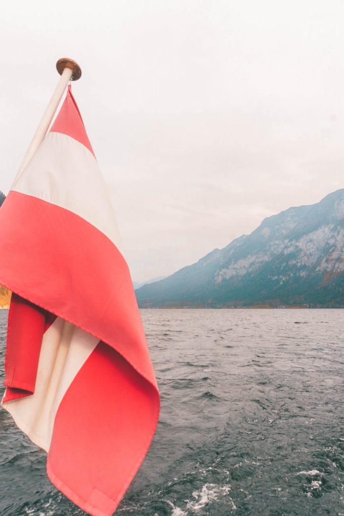 The Austrian flag flying from the back of the Hallstatt ferry