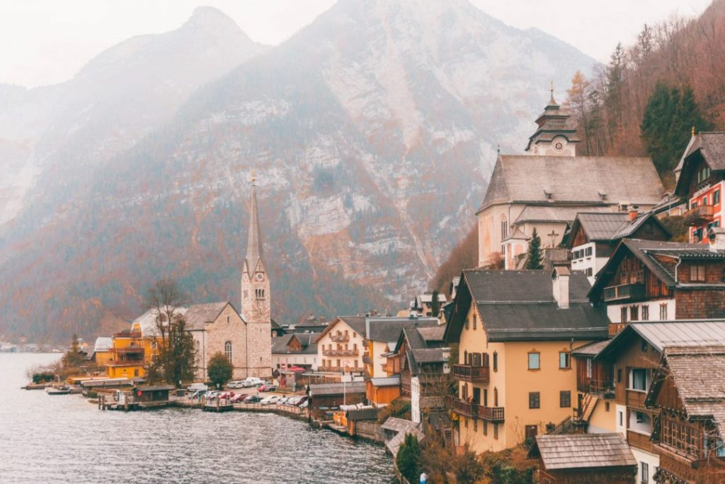 The classic view of Hallstatt: village buildings piled on top of each other and the church at the far edge of the land curving out into the water