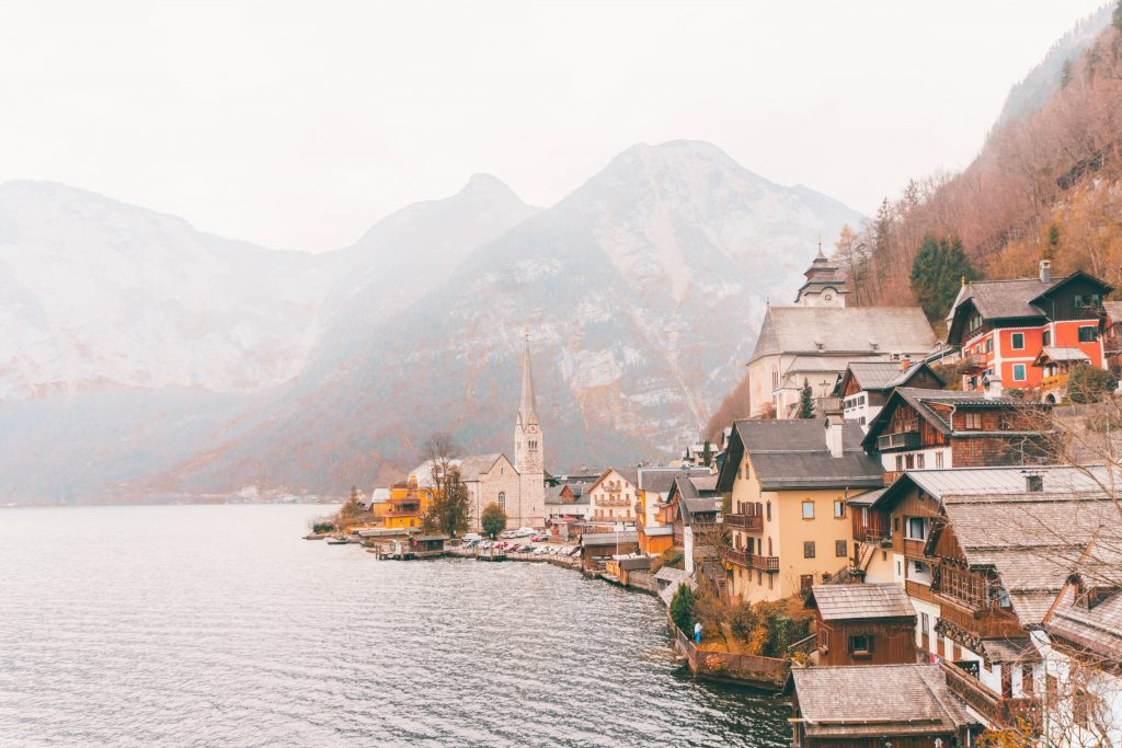 The postcard view of Hallstatt, Austria, with the town curving out into the lake