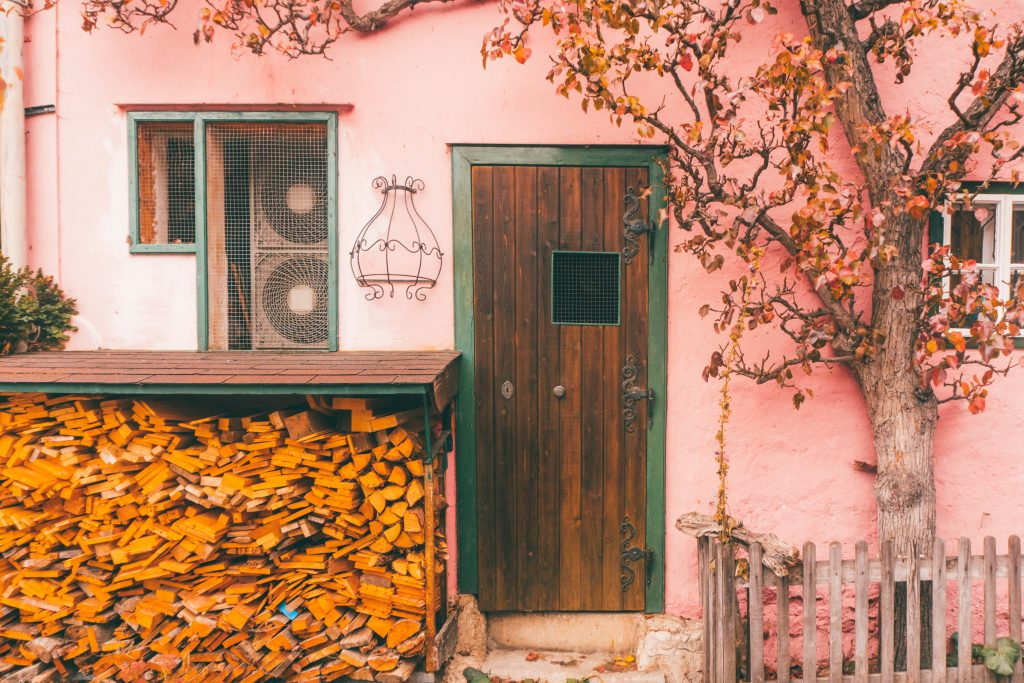 A pink house with a firewood store in Hallstatt, Austria