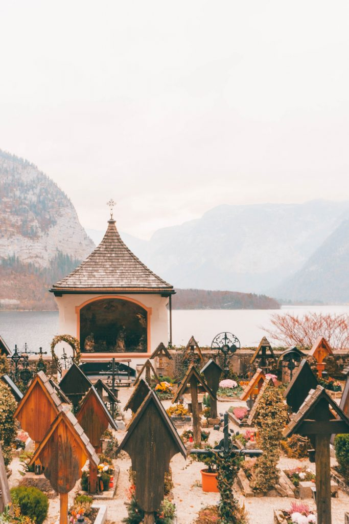The view of Hallstatt Lake and mountains from a small, quaint graveyard.