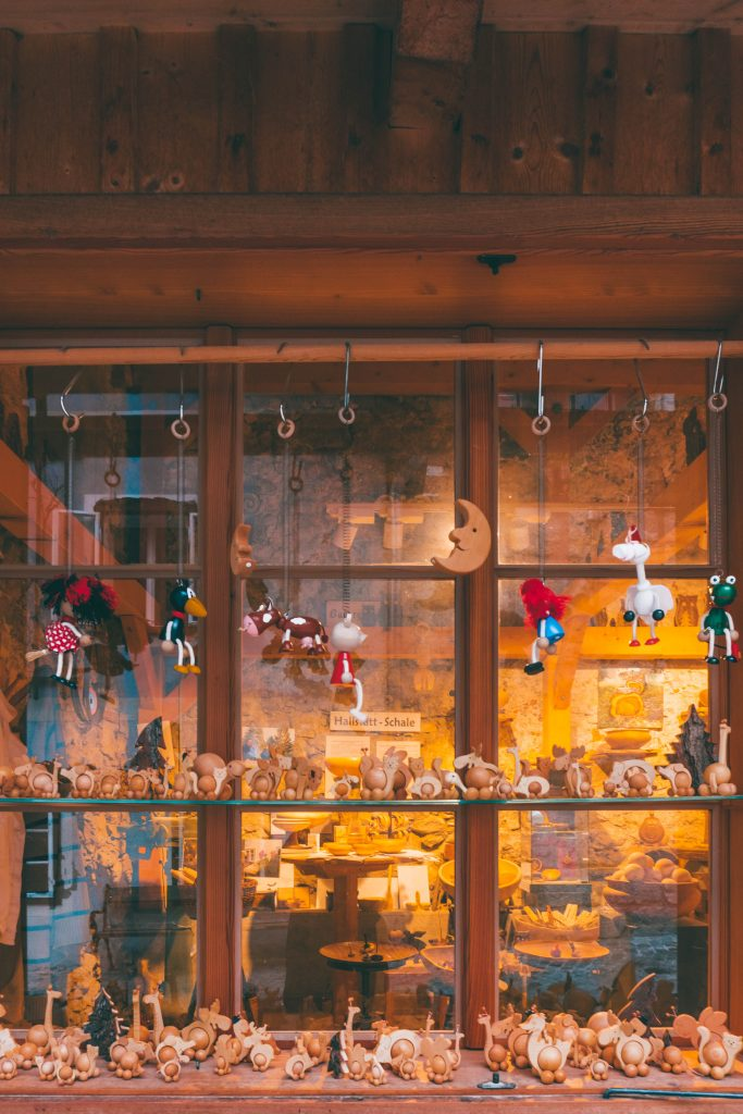 The window of a woodworkers filled with small wooden toys
