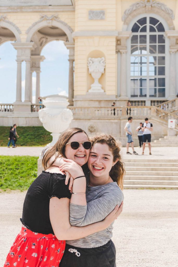 Angela and Addie standing in front of the Gloriette at Schonbrunn Palace in Vienna, Austria