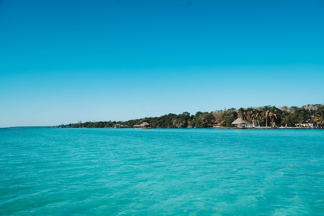 The shoreline of Bacalar, Mexico as seen from the lagoon