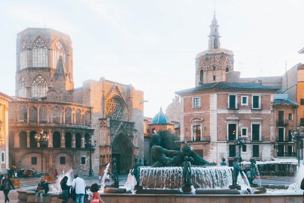 A bustling square at sunset in the old town of Valencia